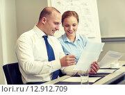Купить «business people with papers meeting in office», фото № 12912709, снято 25 октября 2014 г. (c) Syda Productions / Фотобанк Лори