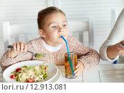 Купить «little girl drinking apple juice at restaurant», фото № 12913081, снято 20 сентября 2015 г. (c) Syda Productions / Фотобанк Лори