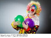 Купить «Funny clown in comical concept», фото № 12919053, снято 1 июля 2015 г. (c) Elnur / Фотобанк Лори
