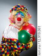 Купить «Funny clown in comical concept», фото № 12919061, снято 1 июля 2015 г. (c) Elnur / Фотобанк Лори