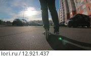 Купить «Девушка едет на самокате по асфальтовой дороге среди припаркованных автомобилей во дворе, вид сзади и снизу», видеоролик № 12921437, снято 18 октября 2015 г. (c) Кекяляйнен Андрей / Фотобанк Лори