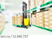 Купить «loader stacker at warehouse», фото № 12945737, снято 4 июня 2015 г. (c) Дмитрий Калиновский / Фотобанк Лори