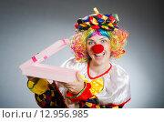 Купить «Funny clown in comical concept», фото № 12956985, снято 1 июля 2015 г. (c) Elnur / Фотобанк Лори