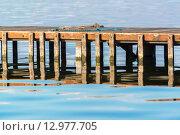 Купить «Wooden pier with chords», фото № 12977705, снято 18 октября 2018 г. (c) PantherMedia / Фотобанк Лори