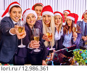 Купить «Business group people in santa hat at corporate Xmas party.», фото № 12986361, снято 23 ноября 2013 г. (c) Gennadiy Poznyakov / Фотобанк Лори