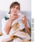 Купить «Young woman having heavy sickly tonsillitis», фото № 12988469, снято 23 марта 2019 г. (c) Яков Филимонов / Фотобанк Лори
