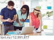 Купить «Creative businessteam working hard together», фото № 12991877, снято 5 июня 2015 г. (c) Wavebreak Media / Фотобанк Лори