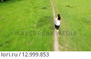 Купить «Fit woman running in a green landscape», видеоролик № 12999853, снято 15 октября 2019 г. (c) Wavebreak Media / Фотобанк Лори