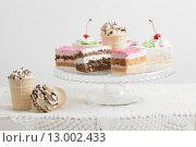 Купить «cakes on white table», фото № 13002433, снято 27 августа 2015 г. (c) Майя Крученкова / Фотобанк Лори
