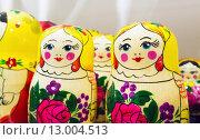 Купить «Яркие красочные матрешки, популярный сувенир», фото № 13004513, снято 30 октября 2015 г. (c) EugeneSergeev / Фотобанк Лори