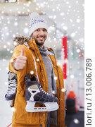 Купить «happy young man showing thumbs up on skating rink», фото № 13006789, снято 26 ноября 2014 г. (c) Syda Productions / Фотобанк Лори