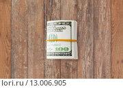 Купить «close uop of dollar money packet tied with rubber», фото № 13006905, снято 30 июля 2015 г. (c) Syda Productions / Фотобанк Лори