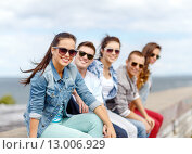 Купить «smiling teenage girl hanging out with friends», фото № 13006929, снято 20 июля 2013 г. (c) Syda Productions / Фотобанк Лори