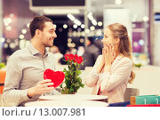 Купить «happy couple with present and flowers in mall», фото № 13007981, снято 10 ноября 2014 г. (c) Syda Productions / Фотобанк Лори