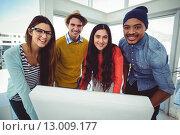 Купить «Young creative team having a meeting», фото № 13009177, снято 5 июня 2015 г. (c) Wavebreak Media / Фотобанк Лори