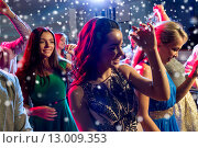Купить «smiling friends dancing in club», фото № 13009353, снято 20 октября 2014 г. (c) Syda Productions / Фотобанк Лори