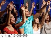 Купить «smiling friends at concert in club», фото № 13009609, снято 20 октября 2014 г. (c) Syda Productions / Фотобанк Лори