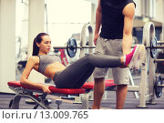 Купить «woman with trainer doing abdominal exercise in gym», фото № 13009765, снято 30 ноября 2014 г. (c) Syda Productions / Фотобанк Лори