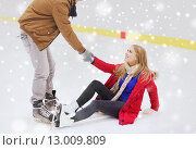 Купить «man helping women to rise up on skating rink», фото № 13009809, снято 26 ноября 2014 г. (c) Syda Productions / Фотобанк Лори