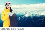 Купить «happy young woman with snowboard over mountains», фото № 13010325, снято 7 февраля 2015 г. (c) Syda Productions / Фотобанк Лори