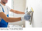 Купить «close up of builder working with grinding tool», фото № 13010593, снято 25 сентября 2014 г. (c) Syda Productions / Фотобанк Лори