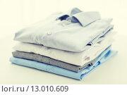 Купить «close up of ironed and folded shirts on table», фото № 13010609, снято 13 ноября 2014 г. (c) Syda Productions / Фотобанк Лори