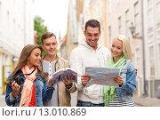 Купить «group of friends with city guide, map and camera», фото № 13010869, снято 14 июня 2014 г. (c) Syda Productions / Фотобанк Лори