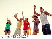 Купить «smiling friends dancing on summer beach», фото № 13030209, снято 3 августа 2014 г. (c) Syda Productions / Фотобанк Лори