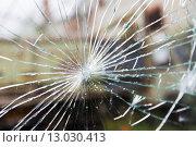 Купить «broken glass with cracks», фото № 13030413, снято 30 сентября 2015 г. (c) Syda Productions / Фотобанк Лори