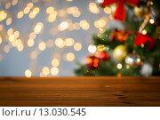 Купить «empty wooden surface over christmas tree lights», фото № 13030545, снято 7 октября 2015 г. (c) Syda Productions / Фотобанк Лори