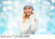 Купить «smiling young woman in winter hat and sweater», фото № 13030689, снято 8 октября 2015 г. (c) Syda Productions / Фотобанк Лори