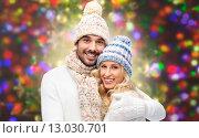 Купить «happy couple in winter clothes hugging over lights», фото № 13030701, снято 8 октября 2015 г. (c) Syda Productions / Фотобанк Лори