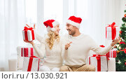 happy couple with christmas gifts and thumbs up. Стоковое фото, фотограф Syda Productions / Фотобанк Лори