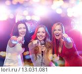Купить «happy women singing karaoke and dancing», фото № 13031081, снято 20 октября 2013 г. (c) Syda Productions / Фотобанк Лори