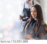 Купить «happy young woman coloring hair at salon», фото № 13031089, снято 15 февраля 2015 г. (c) Syda Productions / Фотобанк Лори