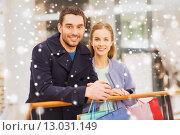 Купить «happy young couple with shopping bags in mall», фото № 13031149, снято 10 ноября 2014 г. (c) Syda Productions / Фотобанк Лори