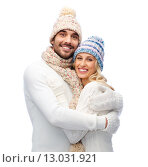smiling couple in winter clothes hugging. Стоковое фото, фотограф Syda Productions / Фотобанк Лори