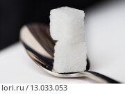 Купить «close up of white sugar cubes on teaspoon», фото № 13033053, снято 16 сентября 2015 г. (c) Syda Productions / Фотобанк Лори