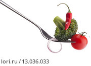Купить «Fresh raw vegetables on fork isolated on white background cutout. Healthy eating concept.», фото № 13036033, снято 26 марта 2013 г. (c) Natalja Stotika / Фотобанк Лори