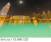 Купить «Dubai - JANUARY 10, 2015: The Address Hotel on January 10 in UAE, Dubai. Address Hotel is popular 5-star hotel.», фото № 13040125, снято 10 января 2015 г. (c) Elnur / Фотобанк Лори
