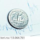 Купить «Курс доллара, монета лежит на графике», фото № 13064761, снято 29 сентября 2015 г. (c) Валерия Потапова / Фотобанк Лори