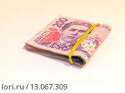 Купить «Пачка украинских денег, купюры 200 гривен», фото № 13067309, снято 15 ноября 2015 г. (c) Ивашков Александр / Фотобанк Лори