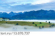 Купить «Sunrise and summer misty mountain country view», фото № 13070737, снято 29 января 2020 г. (c) Юрий Брыкайло / Фотобанк Лори