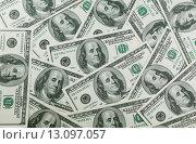 Купить «One hundred dollars pile as background», фото № 13097057, снято 21 ноября 2015 г. (c) Наталья Волкова / Фотобанк Лори