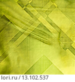 art abstract colorful geometric pattern on paper texture; grunge graphic background in green and yellow colors. Стоковое фото, агентство Ingram Publishing / Фотобанк Лори