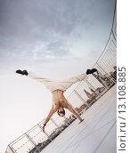 Купить «Muscular guy doing hard exercises», фото № 13108885, снято 6 сентября 2014 г. (c) Ingram Publishing / Фотобанк Лори