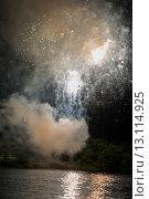 Купить «Fireworks display at night on Canada Day, Kenora, Lake Of The Woods, Ontario, Canada», фото № 13114925, снято 1 июля 2014 г. (c) Ingram Publishing / Фотобанк Лори