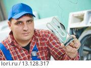 Купить «replacing turbular electric heating element of washing machine», фото № 13128317, снято 22 марта 2019 г. (c) Дмитрий Калиновский / Фотобанк Лори