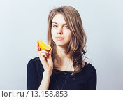 Купить «young beautiful woman with citrus orange fruit having fun.», фото № 13158853, снято 23 апреля 2015 г. (c) Ingram Publishing / Фотобанк Лори