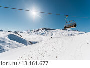 Купить «Ski lifts durings bright winter day», фото № 13161677, снято 27 февраля 2015 г. (c) Elnur / Фотобанк Лори